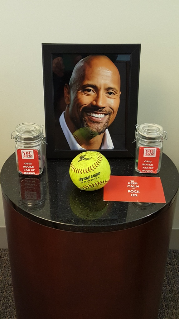 "A shrine to Dwayne ""the Rock"" Johnson in an office."